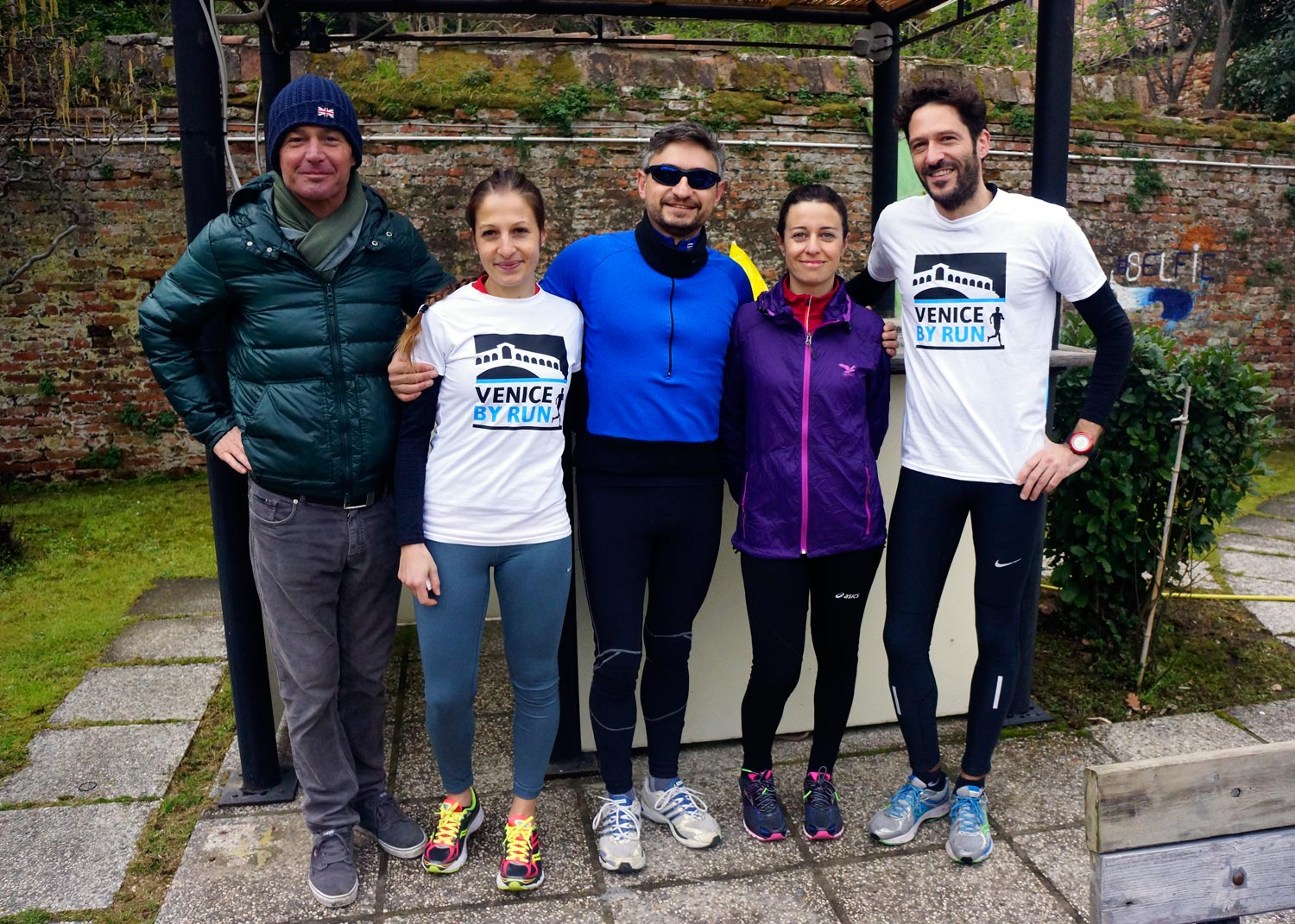 Runners and host in Cantieri Biasin in Venice