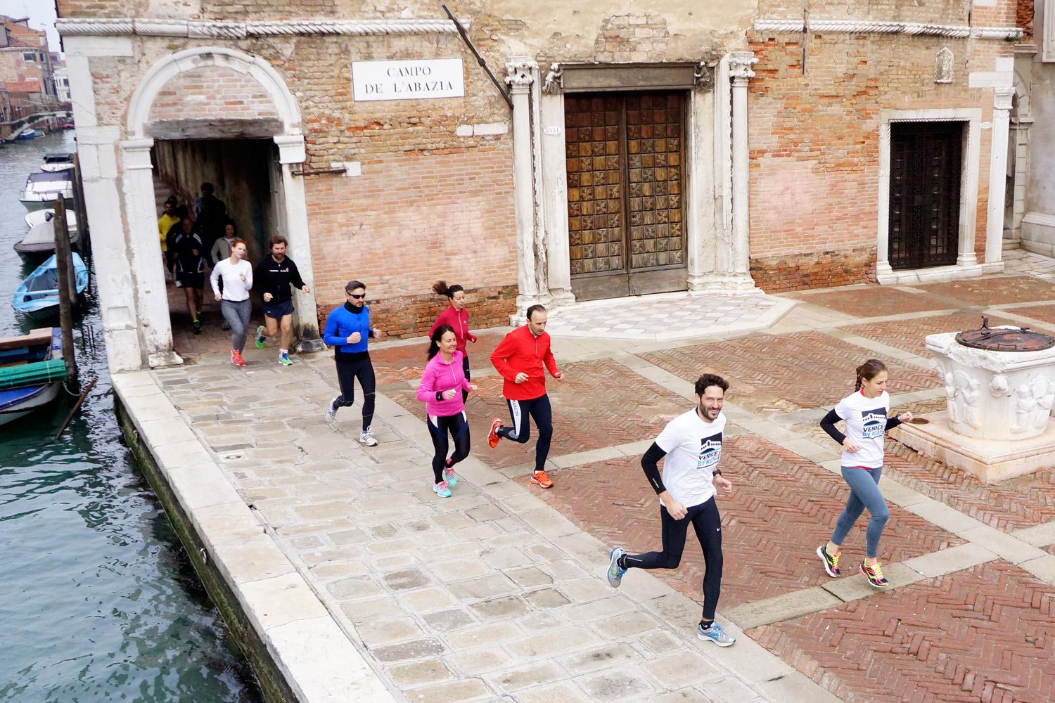 Runners in a campo of Venice