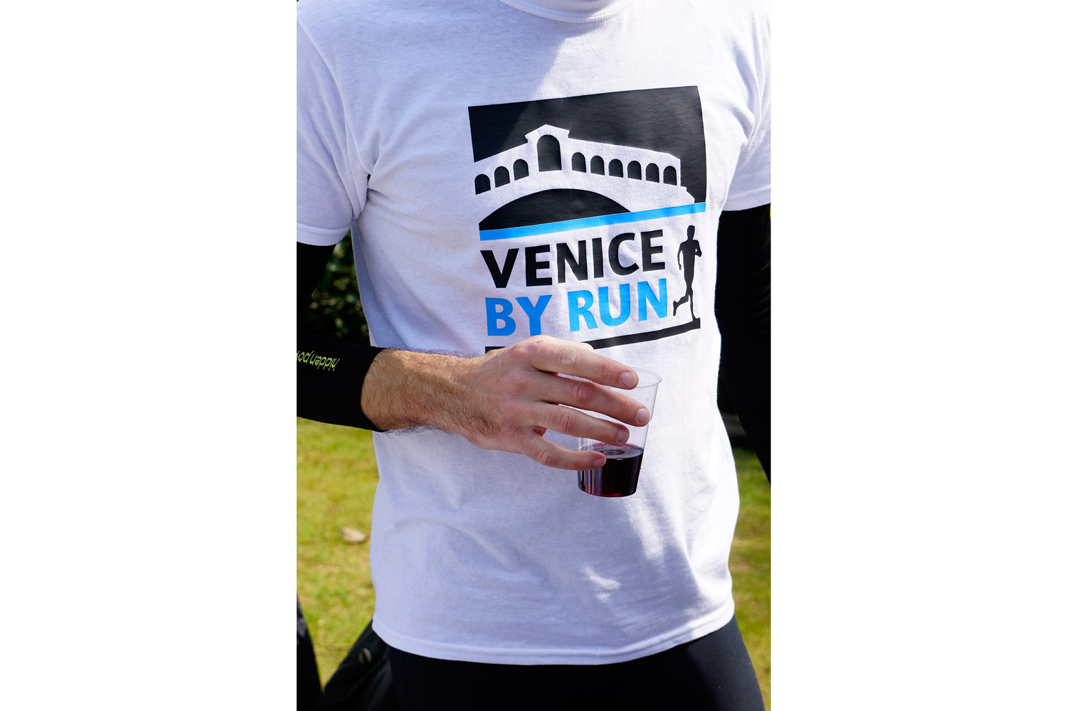 Runner drinking a glass of wine in Venice
