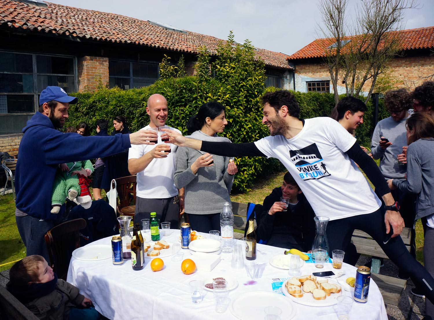 Runners having a cheers in Venice after the run