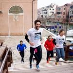 Runners in Venice crossing a bridge