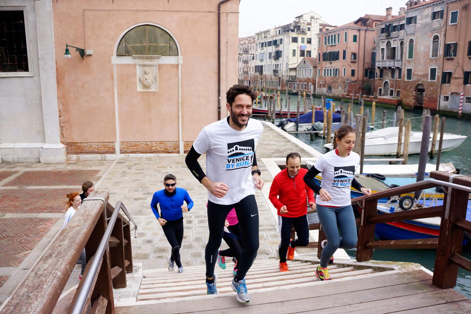 Runners in Venice crossing a bridge
