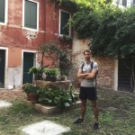 Yolonath in Venice standing in an old and hidden Campo